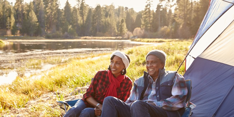 senior couple on autumn camping trip